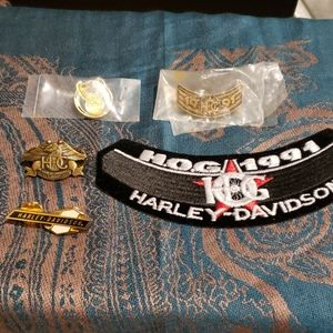 Assortment of Harley Davidson pins and a patch